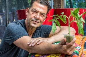 Milo Shammas holding small plant